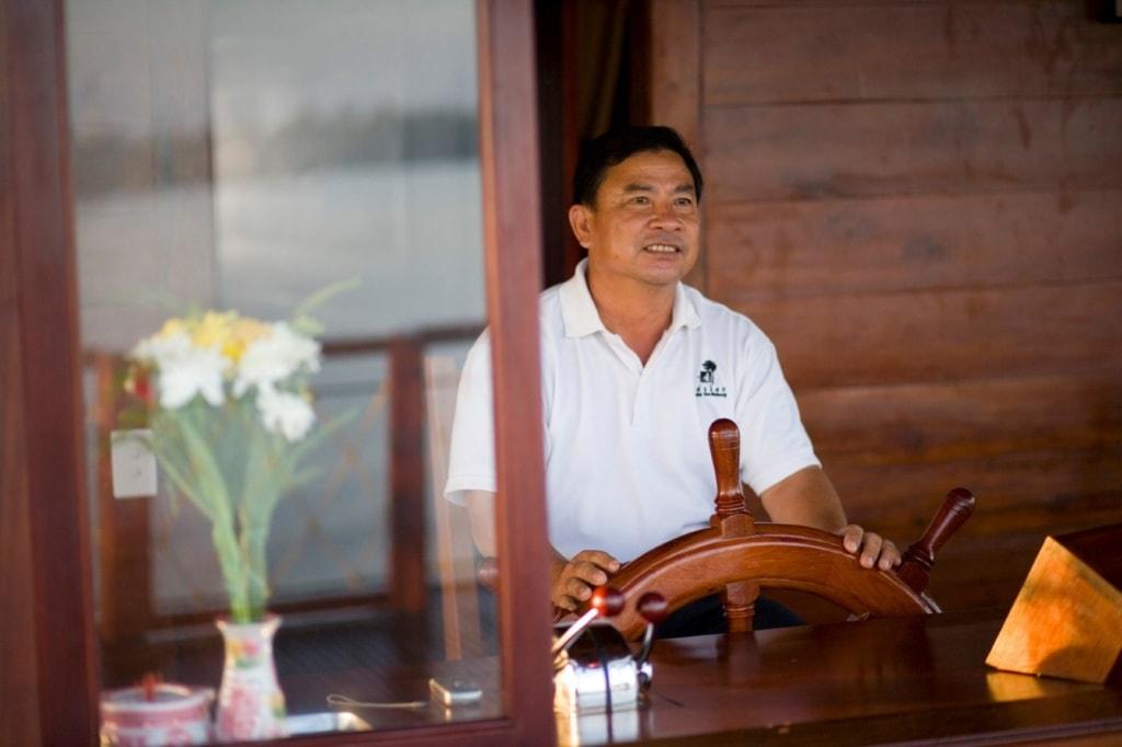 Bootskapitän auf der Bassac Cruise in Vietnam