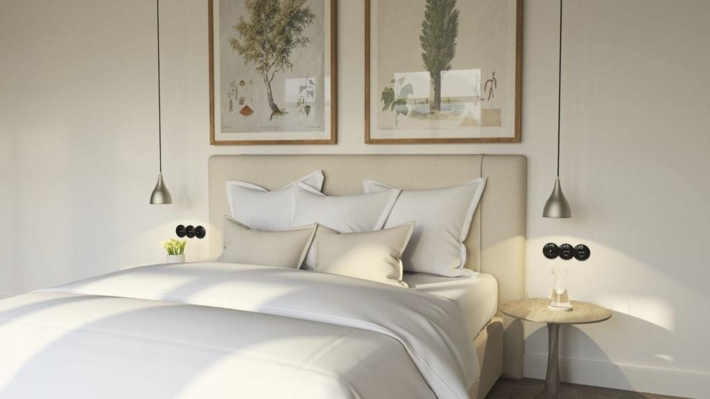 Bett in einem Zimmer der Alpenloge