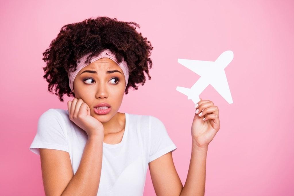 Frau traurig Phobie Panik Flugzeug