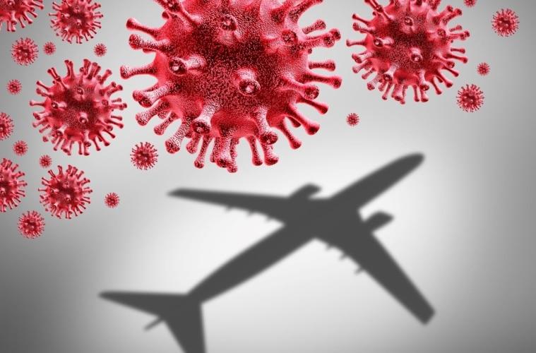 Symbolbild: Rote Corona-Viren und Flugzeug
