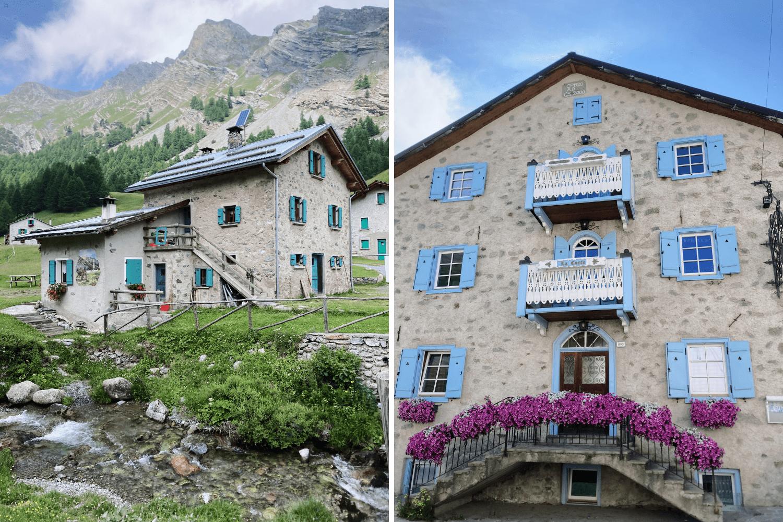 Pensionen mit bunten Fensterläden in einem Ort in den italienischen Alpen